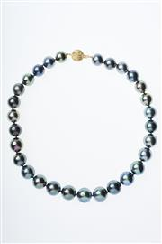 Sale 8299J - Lot 395 - A GRADUATED TAHITIAN PEARL NECKLACE; 12-15mm round cultured pearls of good lust and colour with hues of peacock, blue, aubergine and...