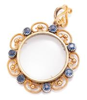 Sale 8965 - Lot 361 - AN ANTIQUE 15CT GOLD SAPPHIRE SET LOCKET; gold bead and wirework frame set with 7 round cut sapphires, size 41 x 32mm, wt. 10g.