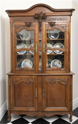 Sale 9248H - Lot 166 - An antique Frenchkitchen dresser with glazed doors over a cupboard base.circa 1780,