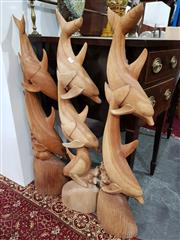 Sale 8740 - Lot 1094 - Set of Three Carved Dolphin Floor Figures
