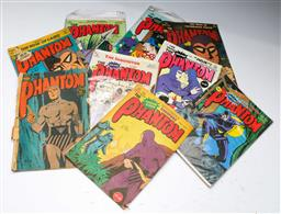 Sale 9148 - Lot 4 - A collection of Phantom comics together with official pin, together with skull and crossbones rings