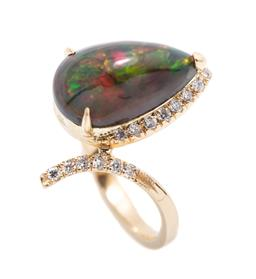 Sale 9253J - Lot 430 - AN 18CT GOLD OPAL AND DIAMOND RING; featuring a pear shape cabochon treated Ethiopian solid opal to wrap around and bypass shoulders...