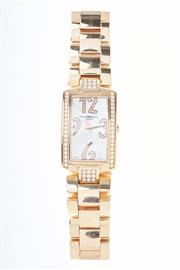 Sale 8322J - Lot 357 - A LADY'S RAYMOND WEIL SHINE 18CT GOLD & DIAMOND WRISTWATCH; mod. 11810 in rose gold with mother of pearl dial, Arabic numerals, beze..