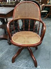 Sale 8666 - Lot 1006 - Late 19th/ Early 20th Century Oak Desk Chair, with rattan panel back & seat, turned gallery & four outswept legs
