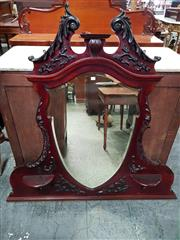 Sale 8848 - Lot 1076 - Late Victorian/ Edwardian Carved Mahogany Overmantle Mirror, with shield shaped mirror & two small shelves