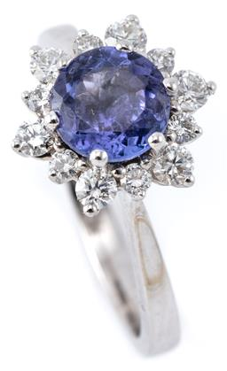 Sale 9132 - Lot 450 - AN 18CT WHITE GOLD TANZANITE AND DIAMOND CLUSTER RING; starburst cluster centring an approx. 1.20ct round cut tanzanite surrounded b...