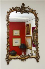 Sale 8205 - Lot 3 - A Rococo style carved and gilt timber mirror with acanthus detail, H 118 x W 72cm