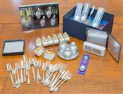 Sale 8402H - Lot 68 - A group of wares comprising commemorative teaspoons, pastry forks, napkin holders, cruets and coasters.
