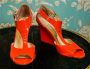 Sale 8448A - Lot 79 - Gorgeous orange patent leather Jimmy Choo London wedge heel shoes Condition: pre-loved good (some scuffs due to wear) Size:41