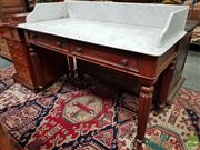 Sale 8485 - Lot 1034 - Victorian Mahogany Washstand, the white marble top with gallery back, above two drawers & turned reeded legs