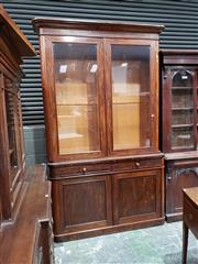 Sale 9048 - Lot 1009 - Good Victorian Mahogany Bookcase, of wider format, with two glass panel doors & rounded corners, two drawers & two timber panel doors