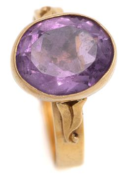 Sale 9095 - Lot 398 - A GOLD SOLITAIRE AMETHYST RING; 3.6mm wide 18ct gold band later applied with a 14 x 11.7mm oval collet in 2 tone 14ct gold rub set w...