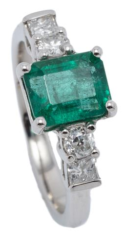 Sale 9132 - Lot 413 - A PLATINUM EMERALD AND DIAMOND RING; bead claw set with an emerald cut emerald of approx. 1.72ct to shoulders each set with a round...