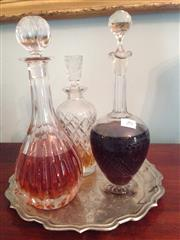 Sale 8048A - Lot 20 - An elegant glass decanter with a narrow neck together with two others and plated tray.