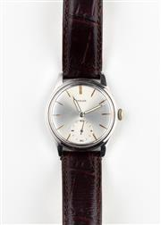 Sale 8770 - Lot 68 - An Omega Stainless Steel Wristwatch; sunburst dial, subsidiary seconds, 15 jewel manual movement, case diam. 35mm, leather band C -...