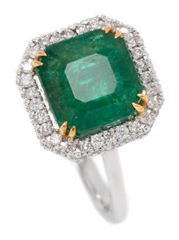 Sale 9160 - Lot 394 - AN 18CT WHITE GOLD EMERALD AND DIAMOND RING; octagonal mount centring a square emerald cut emerald of approx. 2.8ct to a surround of...
