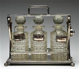 Sale 9211 - Lot 84 - Victorian Silver Plate and Crystal Tantalus (H:30cm)