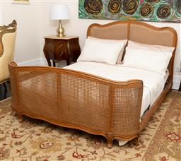Sale 9248H - Lot 224 - A French rattan and carved timber bed (mattress not included). Height 150cm Width 163cm Length 210cm