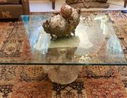Sale 8568A - Lot 48 - A Corinthian capital coffee table, with square glass top, H of pedestal 45cm, glass top W 100 x 100cm, chip to glass see additional...