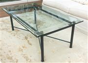 Sale 8838H - Lot 57 - A rectangular glass coffee table with a metal base. Height 48cm x Width 140cm x Depth 79cm