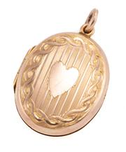 Sale 8965 - Lot 331 - AN EDWARDIAN 9CT GOLD LOCKET; oval hinged locket with engraved front heart and rear with floral bouquet and hallmarks for A.E.J, Bir...