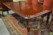Sale 8520 - Lot 1009 - Victorian Mahogany Extension Dining Table, with push-pull mechanism, having two leaves & turned legs