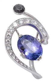 Sale 9020 - Lot 389 - AN ART DESIGN DIAMOND AND TANZANITE RING; tapering crescent set with 20 graduated round brilliant cut diamonds to off centre set ova...