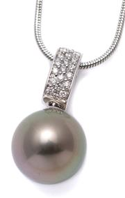 Sale 9083 - Lot 385 - A TAHITIAN PEARL AND DIAMOND ENHACER; 14mm round fine cultured pearl with good lustre on an 18ct white gold hinged bale set with 20...