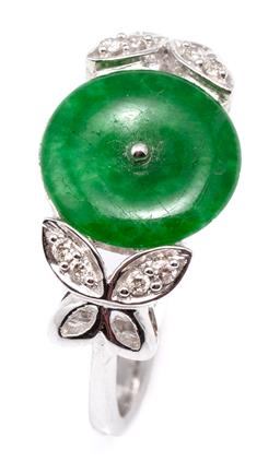Sale 9132 - Lot 579 - AN 18CT GOLD JADE AND DIAMOND RING; centring a 10mm round green jade disc between butterfly motif shoulders set with 8 round brillia...