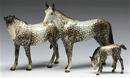 Sale 9153 - Lot 5 - A Beswick family of horses in the rocking horse colour (Largest length 23cm)