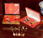 Sale 8107B - Lot 44 - A Collection of gilt teapoons and forks in cases.