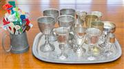 Sale 8402H - Lot 69 - Quantity of EP goblets on an engraved tray, together with swivel sticks in a pewter mug. Length tray, 46cm