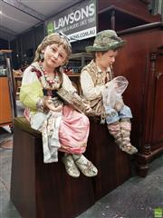Sale 8559 - Lot 1001 - Pair of Large Late 19th/ Early 20th Century German Majolica Seated Figures of Child Musicians, probably in Italian peasant costumes,...