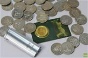 Sale 8618 - Lot 16 - Bradman Coins - 33 Bradman 20c mostly mint, a $5 coin in card and Ron Radfords cigarette lighter! (35)