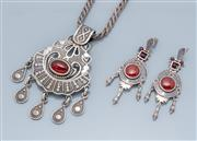 Sale 9037F - Lot 57 - SILVER STONE SET MATCHED PENDANT NECKLACE AND EARRINGS SUITE; pendant 75 x 45mm centring a cabochon carnelian to fringe on twisted f...