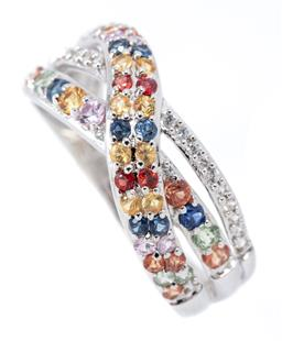 Sale 9186 - Lot 308 - A SILVER GEMSET RING; cross over design set with round cut garnets, sapphires, citrines, amethysts, peridots and zirconias,  width 8...