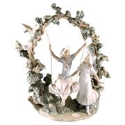 Sale 8000 - Lot 165 - A Lladro figural group with two girls in an arbor, one swinging. Reference no. 1366.
