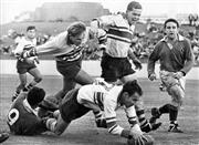 Sale 8754A - Lot 66 - Manly vs Eastwood, Rugby Union Final Match, Sydney Sports Ground, 1966 - Manly forward Earl Flanders takes down Eastwood winger John...