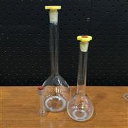 Sale 8758 - Lot 47A - Graduated Set of Three Glass Volumetric Flasks (250 - 5ml) with stoppers