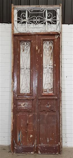 Sale 9188 - Lot 1682A - Rustic timber door with wrought iron inserts and transom (h293 x 100cm)