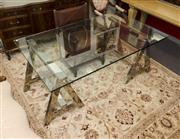 Sale 8205 - Lot 6 - A contemporary chrome and glass topped Ralph Lauren dining table on trestle base, W 110cm x L 181cm x H 76cm