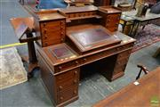 Sale 8485 - Lot 1091 - Victorian Walnut Dickens Style Desk, with gallery back, two banks of 8 drawers, hinged writing slope & unusual sliding side panels...