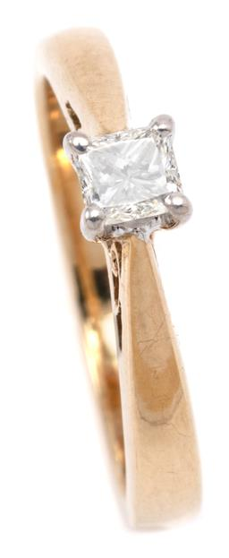 Sale 9132 - Lot 399 - A 9CT GOLD SOLITAIRE DIAMOND RING; beaded claw set with a princess cut diamond of approx. 0.25ct, G/H - SI, size J, wt. 2.38g.