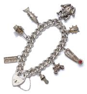 Sale 8999 - Lot 328 - A SILVER CHARM BRACELET; 8mm wide curb link chain to heart shape padlock clasp and safety chain, attached with 8 silver and metal ch...