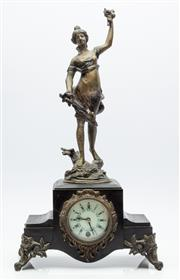 Sale 9070H - Lot 122 - Black slate mantle clock with brass female figure adornment, the white clock face with Roman numeral dial surrounded by ormolu borde...