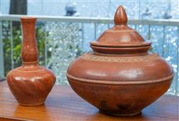 Sale 9164H - Lot 64 - Two pieces of Burmese terracotta ware including a lidded jar, slight damage to lid, and a bulbous vase, height of taller 33cm