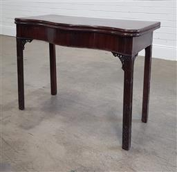 Sale 9240 - Lot 1024 - George III Style Mahogany Card Table, the serpentine top enclosing a green baize interior, above pierced brackets & square blind fre...