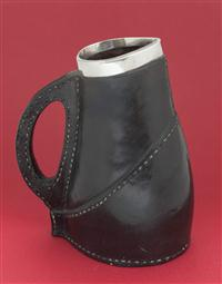 Sale 8160A - Lot 76 - A Doulton Lambeth jug, leather simulated ware, 1887 - Miss Cocks 19cm