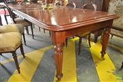 Sale 8267 - Lot 1088 - Victorian Style Mahogany Extension Dining Table, with two leaves, on turned reeded legs (winder in office)