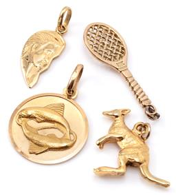 Sale 9132 - Lot 474 - FOUR GOLD CHARMS; a zodiac Pisces disc, 21mm, a leaf drop with profile image, 20mm, a kangaroo, 21mm, all in 18ct, wt. 10.57g, and a...